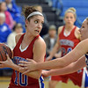 Centaurus' Gianna Manfredini, left, rebounds the ball against Broomfield's Stacie Hull during Tuesday's game at Broomfield.<br /> February 19, 2013<br /> staff photo/ David R. Jennings