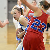 Broomfield's Nicole Lehrer advances the ball against Centaurus' Anna Hubbell during Tuesday's game at Broomfield.<br /> February 19, 2013<br /> staff photo/ David R. Jennings