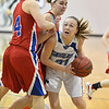 Broomfield's Nicole Lehrer goes to the basket  against Centaurus' Taylor Langer and Anna Hubbell during Tuesday's game at Broomfield.<br /> February 19, 2013<br /> staff photo/ David R. Jennings