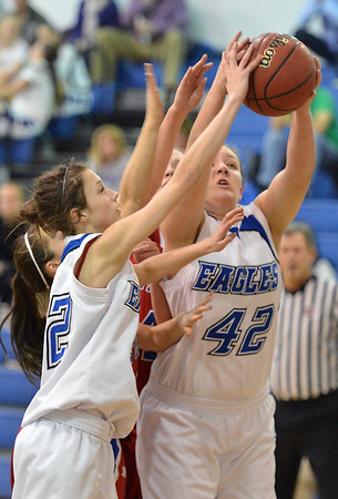 Broomfield's Stacie hull (42) and Brenna Chase rebound the ball against Centaurus during Tuesday's game at Broomfield.<br /> February 19, 2013<br /> staff photo/ David R. Jennings