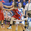 Centaurus' Danelle Dondelinger leaps after the ball through Broomfield's Bri Wilber and Nicole Lehrer during Tuesday's game at Broomfield.<br /> February 19, 2013<br /> staff photo/ David R. Jennings