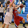 Centaurus' Midori Patterson goes to the basket against Broomfield's Katie Croell during Tuesday's game at Broomfield.<br /> February 19, 2013<br /> staff photo/ David R. Jennings