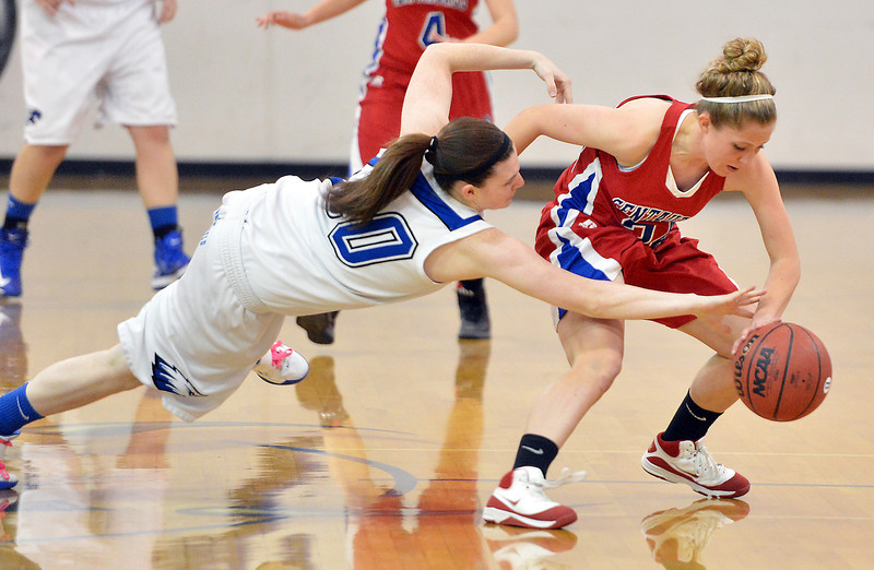 Broomfield's Bri Wilber leaps after the ball against Centaurus' Lauren Esler during Tuesday's game at Broomfield.<br /> February 19, 2013<br /> staff photo/ David R. Jennings