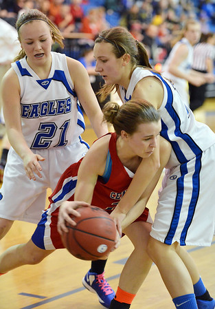 Centaurus' Anna Hubbell dribbles the ball around Broomfield's Katie Croell and Nicole Lehrer during Tuesday's game at Broomfield.<br /> February 19, 2013<br /> staff photo/ David R. Jennings
