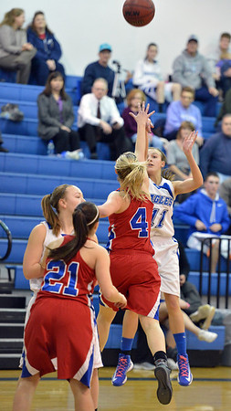 Broomfield's Katie Croell shoots long over Centaurus' Taylor Langer during Tuesday's game at Broomfield.<br /> February 19, 2013<br /> staff photo/ David R. Jennings
