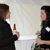 BE10CHAM17<br /> Tara Pederson, left, chats with Sheri DeCosta at the Broomfield Chamber after hours at the Enterprise on Thursday.<br /> October 15, 2009<br /> Staff photo/David R. Jennings