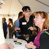 BE10CHAM21<br /> Micheal Campbell, left, chats with Kristin Young, center, and Clea Kessner during the Broomfield Chamber after hours at the Enterprise on Thursday.<br /> October 15, 2009<br /> Staff photo/David R. Jennings