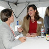 BE10CHAM18<br /> Karen Smith, left, talks with Jill Stravalemos, Broomfield Enteprise, during the Broomfield Chamber after hours at the Enterprise on Thursday.<br /> October 15, 2009<br /> Staff photo/David R. Jennings