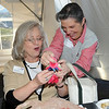 BE10CHAM06<br /> Mary Juszynski, right, gives Kathy Beck a holder for her cellphone during the Broomfield Chamber after hours at the Enterprise on Thursday.<br /> October 15, 2009<br /> Staff photo/David R. Jennings