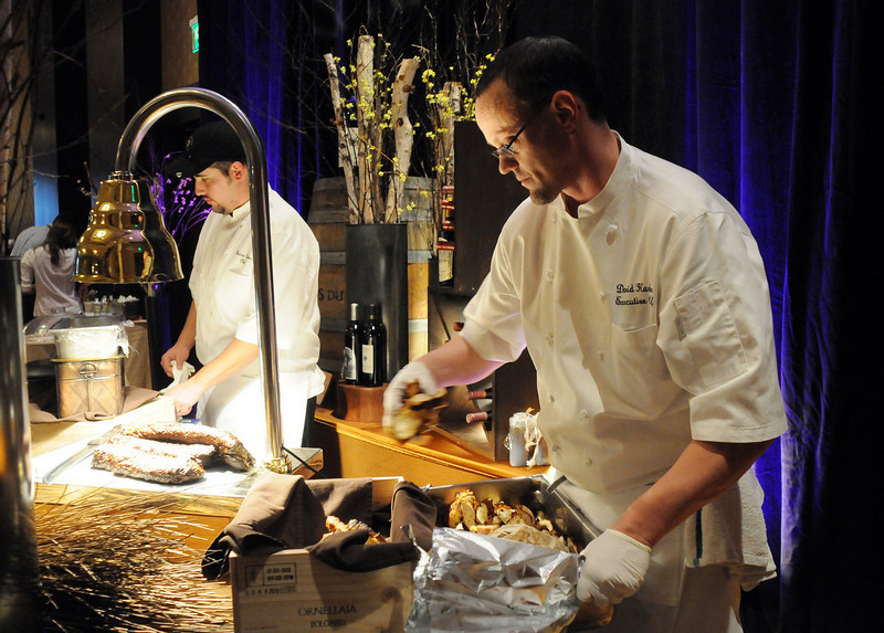 Meritage executive chef David Harker, right, and chef Mario Clapes prepare food for the March of Dimes Signature Chefs Auction at the Omni Interlocken Resort on Thursday.<br /> <br /> October 21, 2010<br /> staff photo/David R. Jennings