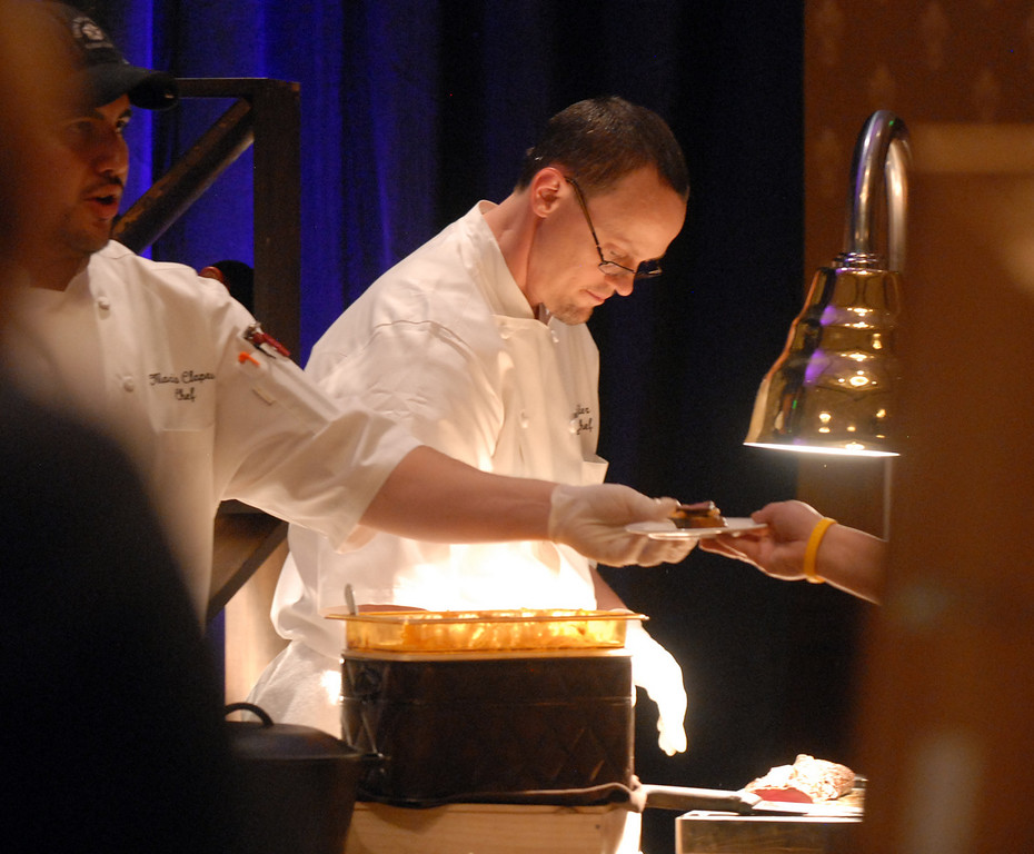 Meritage executive chef David Harker, right, and chef Mario Clapes prepare and serve food for the March of Dimes Signature Chefs Auction at the Omni Interlocken Resort on Thursday.<br /> <br /> October 21, 2010<br /> staff photo/David R. Jennings