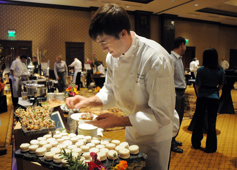 Greenbriar Inn executive chef Eric Johnson puts finishing touches on his food dishes at the March of Dimes Signature Chefs Auction at the Omni Interlocken Resort on Thursday.<br /> <br /> October 21, 2010<br /> staff photo/David R. Jennings