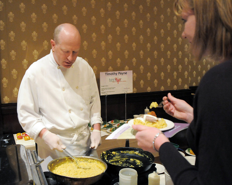Amanda Crowe, right, samples food prepared by executive chef Timothy Payne of Terroir Restaurant at the March of Dimes Signature Chefs Auction at the Omni Interlocken Resort on Thursday.<br /> <br /> October 21, 2010<br /> staff photo/David R. Jennings