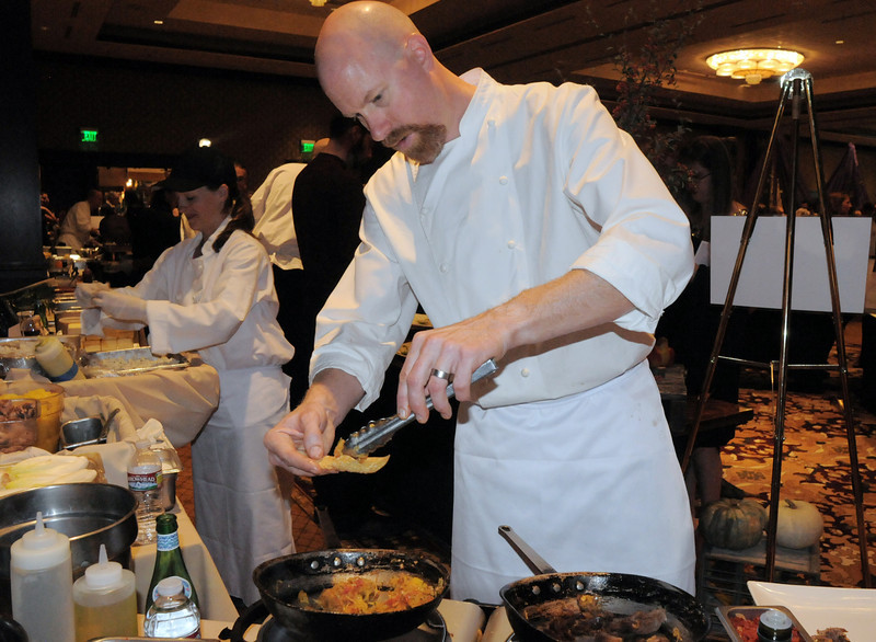 Executive chef Michael Drazsnzak with Colterra Food and Wine perpares a duck leg confit at the March of Dimes Signature Chefs Auction at the Omni Interlocken Resort on Thursday.<br /> <br /> October 21, 2010<br /> staff photo/David R. Jennings