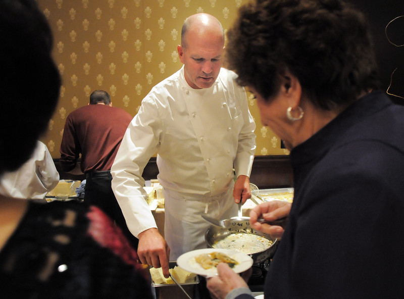 Executive chef Bradford Heap serves his food to attendees during the March of Dimes Signature Chefs Auction at the Omni Interlocken Resort on Thursday.<br /> <br /> October 21, 2010<br /> staff photo/David R. Jennings