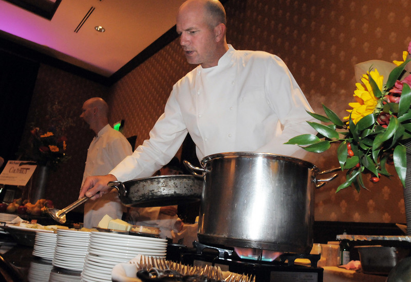 Bradford Heap, executive chef for Salt Bistro, prepares food at the March of Dimes Signature Chefs Auction at the Omni Interlocken Resort on Thursday.<br /> <br /> October 21, 2010<br /> staff photo/David R. Jennings