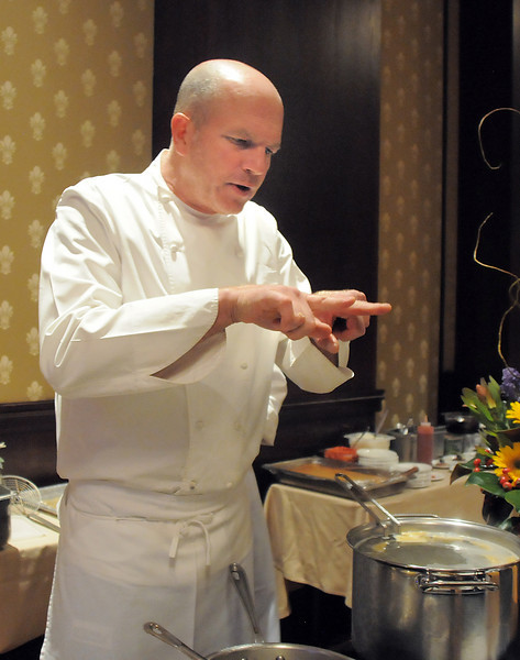 Executive chef Bradford Heap talks to attendees about his food during the March of Dimes Signature Chefs Auction at the Omni Interlocken Resort on Thursday.<br /> <br /> October 21, 2010<br /> staff photo/David R. Jennings