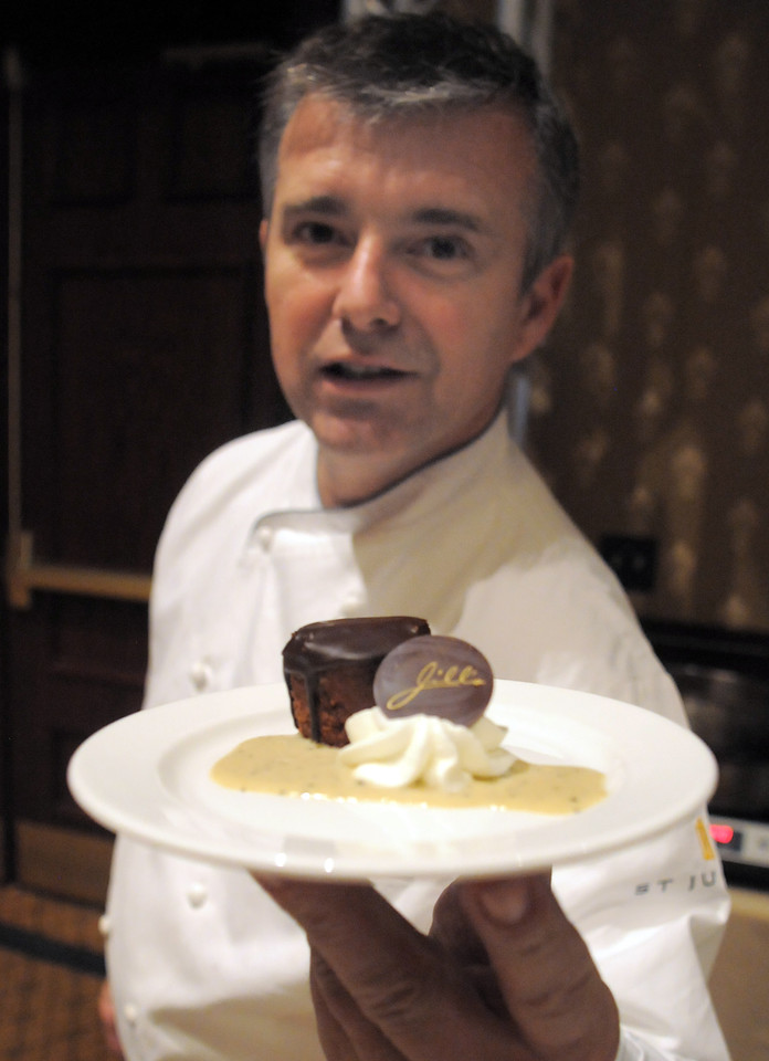 Executive chef Laurent Mechin of Jill's Restaurant at the St. Julien Hotel shows his dark chocolate almond crisp at the March of Dimes Signature Chefs Auction at the Omni Interlocken Resort on Thursday.<br /> <br /> October 21, 2010<br /> staff photo/David R. Jennings