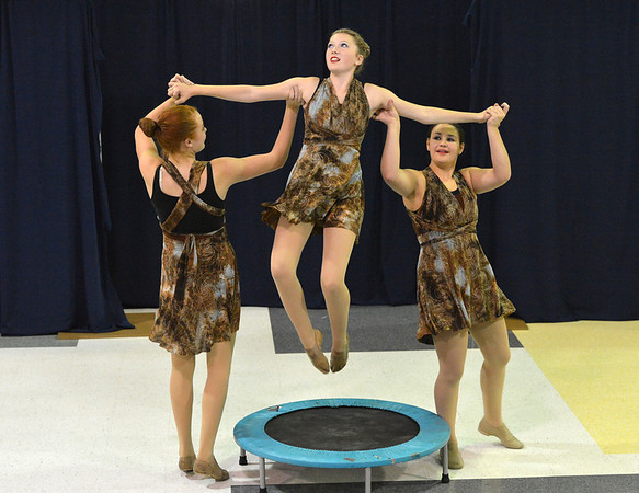 """Katie Effertz, 14, is lifted in the air by Sarah Fanning, 16, left, and Aliyah Price, 15, for a dance about gravity for the Children Dance Theater's production of  """"A Science Adventure on the Magic School Bus"""" at Emerald Elementary School on Friday.<br /> September 21, 2012<br /> staff photo/ David R. Jennings"""
