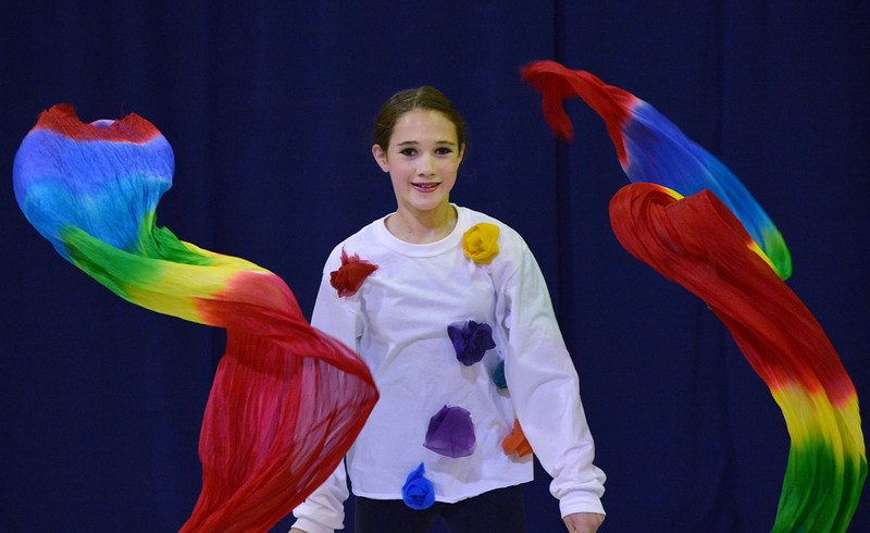 "Rachel Kane, 12, performs a dance about rainbows during the Children Dance Theater's production of ""A Science Adventure on the Magic School Bus"" at Emerald Elementary School on Friday.<br /> September 21, 2012<br /> staff photo/ David R. Jennings"