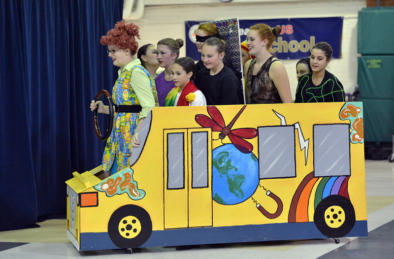 """Nicole HIcks, 14, left, as Mis Frizzle, drives Children Dance Theater members in a bus during the performance of """"A Science Adventure on the Magic School Bus"""" at Emerald Elementary School on Friday.<br /> September 21, 2012<br /> staff photo/ David R. Jennings"""