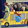 "Nicole HIcks, 14, left, as Mis Frizzle, drives Children Dance Theater members in a bus during the performance of ""A Science Adventure on the Magic School Bus"" at Emerald Elementary School on Friday.<br /> September 21, 2012<br /> staff photo/ David R. Jennings"