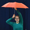 "Nicole Hicks, 14, raises an umbrella for a dance about the weather during the Children Dance Theater's production of ""A Science Adventure on the Magic School Bus"" at Emerald Elementary School on Friday.<br /> September 21, 2012<br /> staff photo/ David R. Jennings"