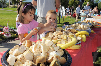Isabelle Jezierski, left, and her brother Alexander, 5, pick out food for breakfast during  Saturday's 2011 Children's Wellness Adventure at Community Park. August 27, 2011 staff photo/ David R. Jennings