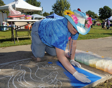 Chalk Artist Mythica von Griffyn makes a chalk art design on the sidewalk during  Saturday's 2011 Children's Wellness Adventure at Community Park. August 27, 2011 staff photo/ David R. Jennings