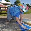 Chalk Artist Mythica von Griffyn makes a chalk art design on the sidewalk during  Saturday's 2011 Children's Wellness Adventure at Community Park.<br /> August 27, 2011<br /> staff photo/ David R. Jennings