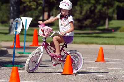Isabelle Zuniga, 5 1/2, rides her way through the bicycle saftey course during  Saturday's 2011 Children's Wellness Adventure at Community Park.  August 26, 2011 staff photo/ David R. Jennings