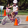 Isabelle Zuniga, 5 1/2, rides her way through the bicycle saftey course during  Saturday's 2011 Children's Wellness Adventure at Community Park.<br /> <br /> August 26, 2011<br /> staff photo/ David R. Jennings