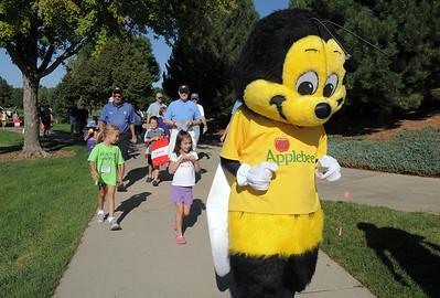 The Applebee's Bee lead the Walk4Kids' Health walk during  Saturday's 2011 Children's Wellness Adventure at Community Park. August 27, 2011 staff photo/ David R. Jennings