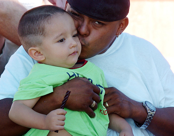 Luis Garcia gives his son Donavan, 2, a kiss during  Saturday's 2011 Children's Wellness Adventure at Community Park.<br /> <br /> August 26, 2011<br /> staff photo/ David R. Jennings
