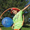 Alex Jezierski, 6, tries to do the Hula hoop during  Saturday's 2011 Children's Wellness Adventure at Community Park.<br /> August 27, 2011<br /> staff photo/ David R. Jennings