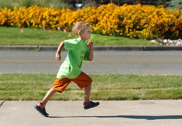 Alex Jezierski, 6, runs during the Walk4Kids' Health around the Community Park pond at Saturday's 2011 Children's Wellness Adventure.<br /> August 27, 2011<br /> staff photo/ David R. Jennings