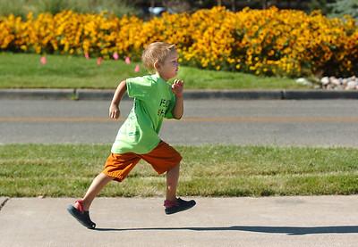 Alex Jezierski, 6, runs during the Walk4Kids' Health around the Community Park pond at Saturday's 2011 Children's Wellness Adventure. August 27, 2011 staff photo/ David R. Jennings