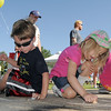 Tyler Dunn, 4, left, and Bella Schnepp, 5, work on their chalk art during  Saturday's 2011 Children's Wellness Adventure at Community Park.<br /> August 27, 2011<br /> staff photo/ David R. Jennings