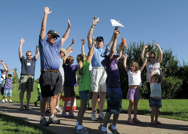 Broomfield Mayor Pat Quinn and Jack Terhar stretch with children during the Walk4Kid's Health around the Community Park pond at Saturday's 2011 Children's Wellness Adventure.<br /> August 27, 2011<br /> staff photo/ David R. Jennings