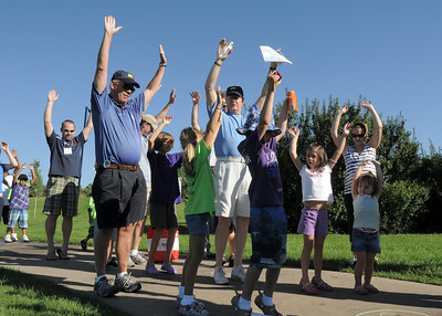 Broomfield Mayor Pat Quinn and Jack Terhar stretch with children during the Walk4Kid's Health around the Community Park pond at Saturday's 2011 Children's Wellness Adventure. August 27, 2011 staff photo/ David R. Jennings