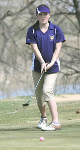 Boulder's Anna Cutler watches her putt on the 18th green at the Chilly/Chili Invite golf tournament hosted by Broomfield High School at the Eagle Trace golf Course on Saturday. March 17,  2012  staff photo/ David R. Jennings
