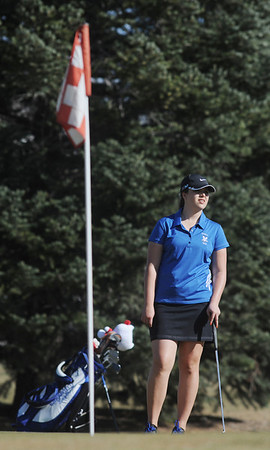 Broomfield's Alex Briggs waits her turn to putt on the 9th hole at the Chilly/Chili Invite golf tournament hosted by Broomfield High School at the Eagle Trace golf Course on Saturday.<br /> March 17,  2012 <br /> staff photo/ David R. Jennings