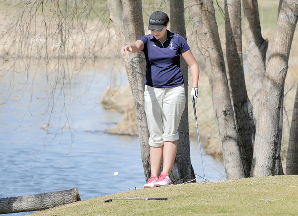 Legacy's Morgan Stacks drops the ballon the 6th hole at the Chilly/Chili Invite golf tournament hosted by Broomfield High School at the Eagle Trace golf Course on Saturday.<br /> March 17,  2012 <br /> staff photo/ David R. Jennings