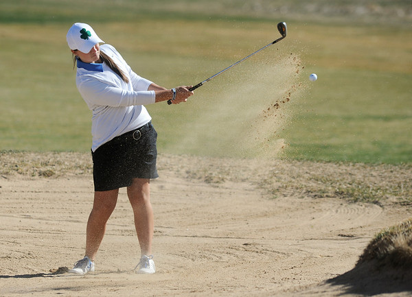 Taylor Dorans, Broomfield, chips out of a sand trap on the 11th hole at the Chilly/Chili Invite golf tournament hosted by Broomfield High School at the Eagle Trace golf Course on Saturday.<br /> March 17,  2012 <br /> staff photo/ David R. Jennings