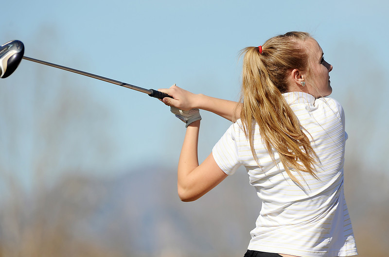 Skyline's Haiden DeJane tees off of the 10th hole at the Chilly/Chili Invite golf tournament hosted by Broomfield High School at the Eagle Trace golf Course on Saturday.<br /> March 17,  2012 <br /> staff photo/ David R. Jennings