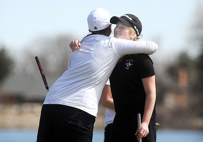 Broomfeild's Taylor Dorans, left, hugs Fairview's Kelly Moran after finishing the tournament at the Chilly/Chili Invite golf tournament hosted by Broomfield High School at the Eagle Trace golf Course on Saturday. March 17,  2012  staff photo/ David R. Jennings