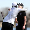 Broomfeild's Taylor Dorans, left, hugs Fairview's Kelly Moran after finishing the tournament at the Chilly/Chili Invite golf tournament hosted by Broomfield High School at the Eagle Trace golf Course on Saturday.<br /> March 17,  2012 <br /> staff photo/ David R. Jennings