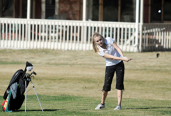 Skyline's Haiden DeJane chips the ball on the 9th hole at the Chilly/Chili Invite golf tournament hosted by Broomfield High School at the Eagle Trace golf Course on Saturday.<br /> March 17,  2012 <br /> staff photo/ David R. Jennings