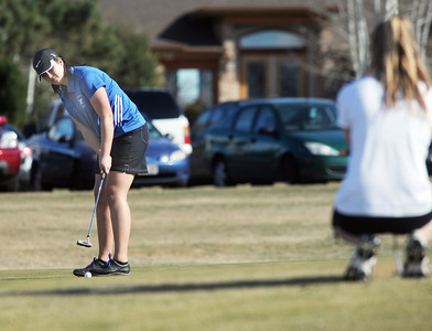 Broomfield's Alex Briggs makes a putt on the 9th while skyline's Haiden DeJane watches at the Chilly/Chili Invite golf tournament hosted by Broomfield High School at the Eagle Trace golf Course on Saturday. March 17,  2012  staff photo/ David R. Jennings