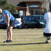 Broomfield's Alex Briggs makes a putt on the 9th while skyline's Haiden DeJane watches at the Chilly/Chili Invite golf tournament hosted by Broomfield High School at the Eagle Trace golf Course on Saturday.<br /> March 17,  2012 <br /> staff photo/ David R. Jennings